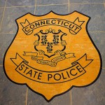 "Custom made tile ""badge"" inlay in main entrance of CT State Police Museum."
