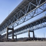 View of Goldstar Memorial Bridge in New London, CT from parking lot by boat launch under bridge.